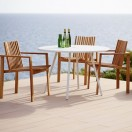 area table with teak chairs